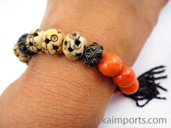 """Fancy """"Persimmon"""" tassel bracelet, featuring brass, carved bone and glass beads."""