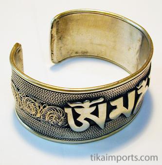 side view of handcrafted silver-brass wide om cuff bracelet