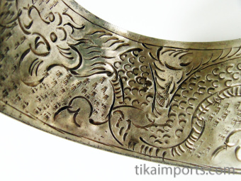 reverse of cuff showing inscribed dragon motif