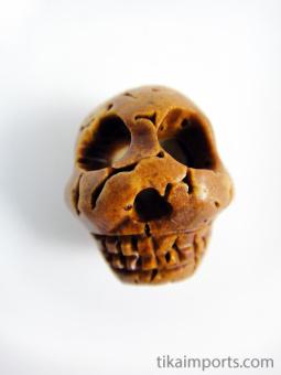 carved walnut skull bead