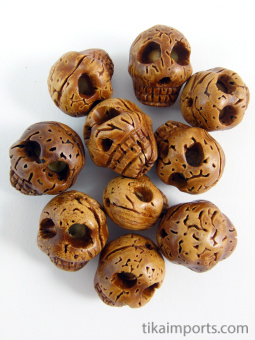 carved walnut skull beads