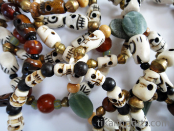 Closeup of assorted skull stretch bracelets showing variety
