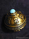 Miniature brass and copper prayer-wheel bead with either coral or turquoise colored glass inlay