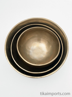 Set of 3 nesting Brass Singing Bowls, used to create a resonant tone for meditation, with wood or leather wrapped mallets