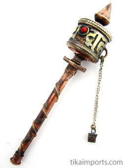 This is a miniature brass and copper prayer-wheel