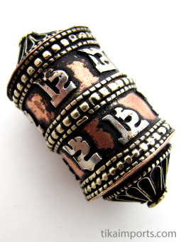 Miniature brass and copper prayer-wheel bead that opens and contains a printed prayer