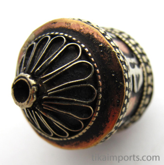 showing end hole of Miniature brass and copper prayer-wheel bead