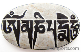 showing back of Hand-carved Mani Stone which reads om mani padme hum