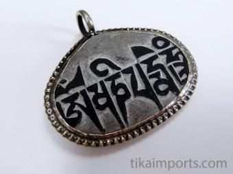 Reverse veiw of hand-carved Mani Stone Pendant