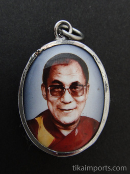 His Holiness, the Dalai Lama, exiled Spiritual leader of Tibet, and Nobel Peace Prize winner, with gray background.