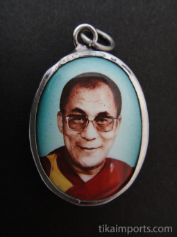 His Holiness, the Dalai Lama, exiled Spiritual leader of Tibet, and Nobel Peace Prize winner, with teal background.