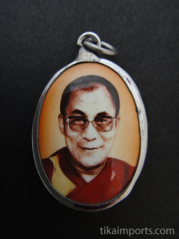 His Holiness, the Dalai Lama, exiled Spiritual leader of Tibet, and Nobel Peace Prize winner, with orange background.
