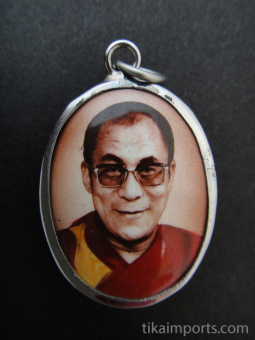 His Holiness, the Dalai Lama, exiled Spiritual leader of Tibet, and Nobel Peace Prize winner, with brick background.