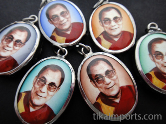Assortment of His Holiness, the Dalai Lama pendants, exiled Spiritual leader of Tibet, and Nobel Peace Prize winner.