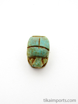 top view of tiny scarab bead, hole goes through from head to end