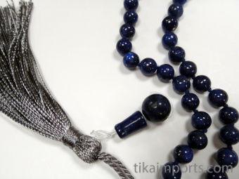Hand carved Lapis Lazuli Guru Bead set along side other mala materials