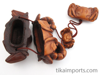 handcarved inro box of crab and octopus showing open box and inner compartments.
