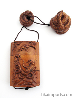 snake inro box with netsuke and ojime slider bead.