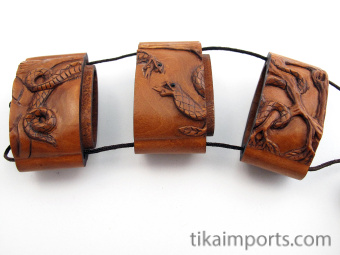 snake inro box with netsuke and ojime slider bead, showing open box with three inner compartments.