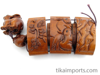 large handcarved boxwood Inro Box with rabbits, showing open box with three inner compartments