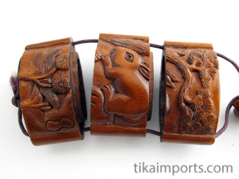 small handcarved boxwood Inro with bunny rabbits showing open box with inner compartments