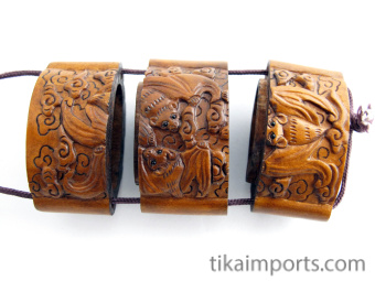 Small inro box with carved bats, showing three inner compartments