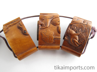small handcarved boxwood inro box of frogs, showing open box with three inner compartments