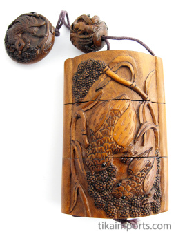 handcarved boxwood Inro box with rooster, showing reverse side of chics feeding