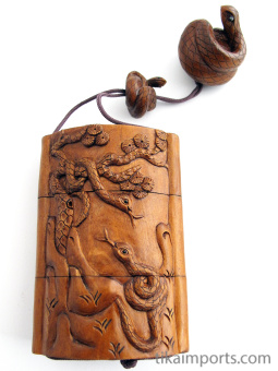handcarved boxwood Inro box with cobra snakes, showing reverse side