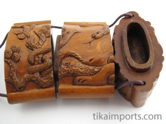 handcarved boxwood Inro box with cobra snakes, showing three inner compartments