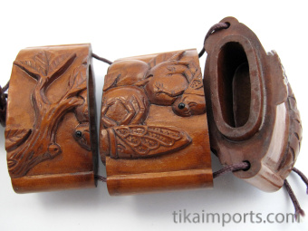 handcarved boxwood Inro box with carved Cicadas showing open box with three inner compartments