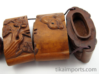 handcarved boxwood Inro box with squirrels, showing open box with three inner compartments