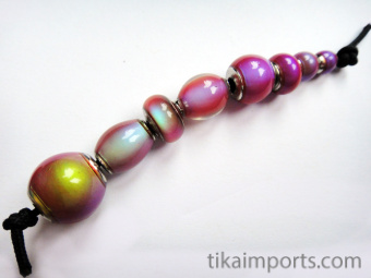 Sample strand of our hot pink color-changing Mirage Beads with brass core