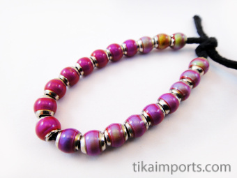 Strand of our hot pink color-changing Mirage beads with brass core