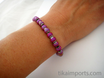 Color changing Hot Pink Mirage beads on an elastic bracelet
