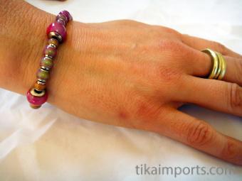 Color changing Hot Pink Mirage bead bracelet warming up!