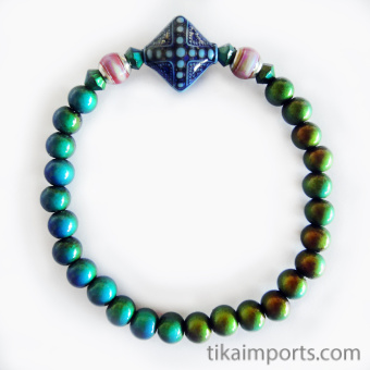 color-changing Micro Mirage Bead stretch bracelet with Sapphire center bead