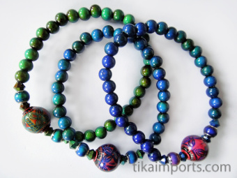 color-changing Micro Mirage Bead stretch bracelet with Round-Ruby center bead