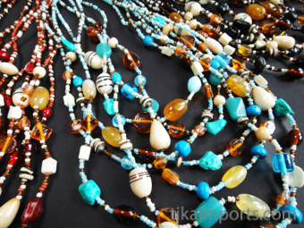 Glass and agate multi-strand Malala Necklaces, available in 10pc assortments of blue, red and black tones