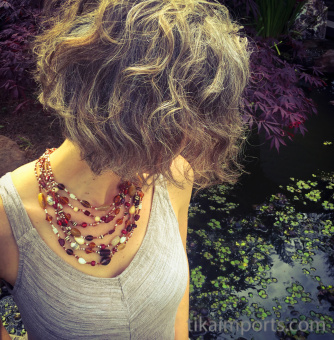Glass and natural stone multi-strand Beaded Necklace in tones of red and brown.
