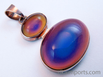 color-changing mirage cabochon set in sterling silver setting