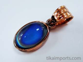 color-changing mirage cabochon set in pure copper