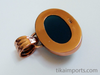 reverse view of color-changing mirage cabochon set in pure copper