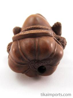 handcarved boxwood netsuke of sumo frog showing hole through the base