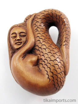 handcarved boxwood netsuke of resting mermaid