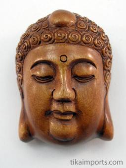 handcarved boxwood netsuke of buddha face