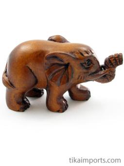 handcarved boxwood netsuke of walking elephant