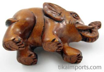 handcarved boxwood netsuke of walking elephant showing hole through underside