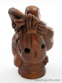 handcarved boxwood netsuke of buddha showing hole on reverse side