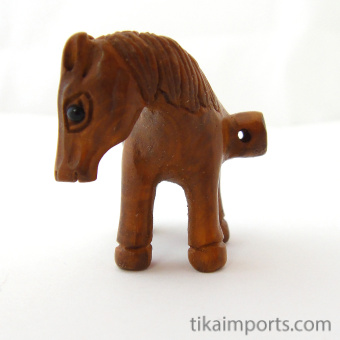 side view of handcarved boxwood horse button